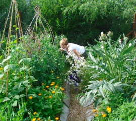 Gabrielle working in the vegetable patch